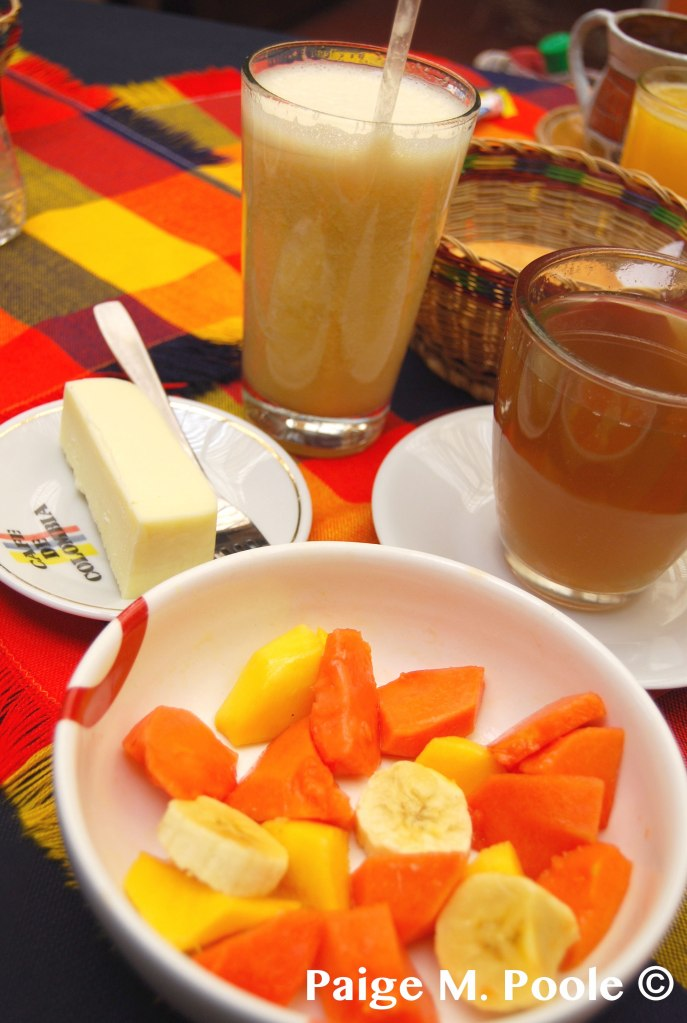 Breakfast in Boyacá:  Artisan cheese, peach juice, fruit bowl almojábana, and agua de panela