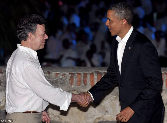 (President Santos and President Obama giving a firm-handshake) Image from: http://www.dailymail.co.uk/news/article-2130285/Rep-Darrell-Issa-says-Secret-Service-prostitution-scandal-sign-wider-corruption-agency.html